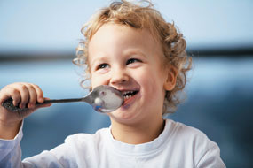 Child With Spoon